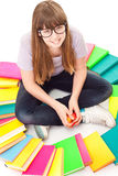 Child with lot of books siting on floor Royalty Free Stock Photo