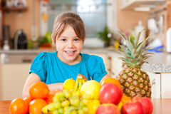 Child with lots of fruits for breakfast food royalty free stock photos