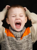 Child loudly shouts Royalty Free Stock Image