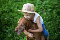 Child love his dog. Outdoor portrait: Child love his Hungarian Vizsla Royalty Free Stock Photo