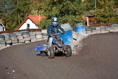 Child loves to race with a quad bike Stock Photography