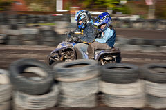 Child loves to race with a quad Stock Images