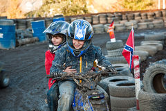 Child loves to race with a quad bike Royalty Free Stock Image