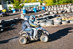 Child loves to race with a quad Stock Photo