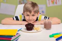 Child loving sweet unhealthy food Royalty Free Stock Image