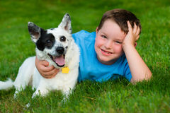 Child lovingly embraces his pet Stock Images