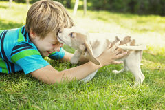 Child lovingly embraces his pet dog Stock Image