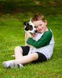 Child lovingly embraces his pet dog Royalty Free Stock Image