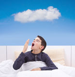 Child lying in bed Stock Photography