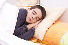 Child lying in bed Stock Photos