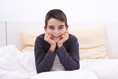 Child lying in bed Royalty Free Stock Photo