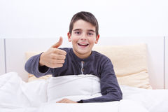 Child lying in bed Royalty Free Stock Photography