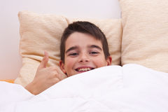 Child lying in bed Stock Photo