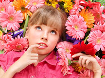 Child lying  on the flowers. Royalty Free Stock Photo