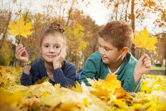 Child lying on the golden leaf Stock Photo