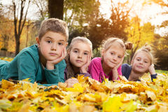 Child lying on the golden leaf Royalty Free Stock Photo