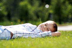 Child lying on the grass. Royalty Free Stock Photography