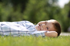 Child lying on the grass. Royalty Free Stock Images