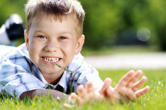 Child lying on the grass. Stock Photos