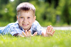 Child lying on the grass. Royalty Free Stock Photo