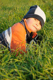 Child lying in grass Royalty Free Stock Image