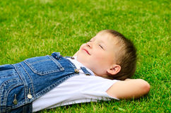 Child lying on the grass. Stock Photography