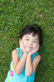 Child lying on grass Royalty Free Stock Photography