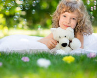 Child lying on grass Stock Photo