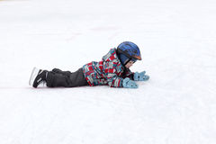Child lying on the rink Royalty Free Stock Photos