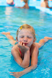 Child lying in the shallow water Stock Images