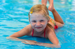 Child lying in the shallow water Royalty Free Stock Images