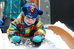 Child lying on slide Royalty Free Stock Image