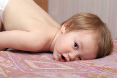 Child lying and staring. Closeup portrait Stock Photos