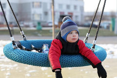 Child lying on a swing Royalty Free Stock Images