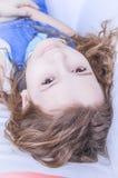 Child lying upside down Stock Photo