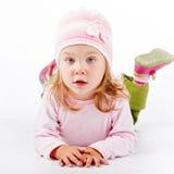 Child lying on white stock photos