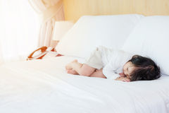 Child lying in white bedding room for copy space. Child lying in white bedding room with copy space Royalty Free Stock Photography