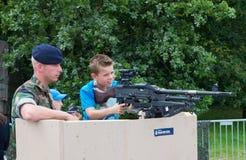 Child with machine gun Royalty Free Stock Photo