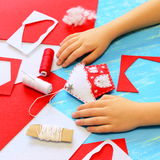 Child made a felt Christmas tree house decoration. Child show Christmas house decoration. Tools and materials for sewing crafts. Royalty Free Stock Images