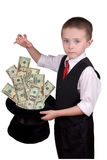 Child Magician. Child dressed as a magician with hat full of money isolated over a white background Stock Image