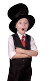 Child Magician. Young boy dressed as a magician with a hat and arms crossed over a white background Royalty Free Stock Photography