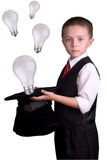Child Magician with ideas. Child dressed as a magician with hat full of ideas isolated over a white background stock photography