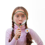 Child magnifying glass Royalty Free Stock Images