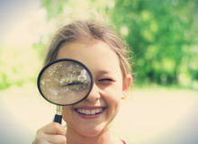 child and magnifying glass Stock Images
