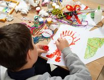 Child make crafts and toys, handmade concept. Artwork workplace with creative accessories. Royalty Free Stock Image
