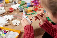 Child make crafts and toys, handmade concept. Artwork workplace with creative accessories. royalty free stock images