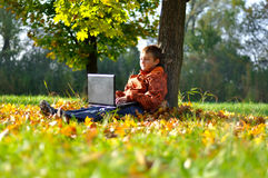 Child make fun with laptop Royalty Free Stock Photography