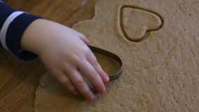 Child makes biscuits for baking stock video