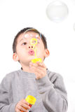 The child makes bubbles on white Royalty Free Stock Photo
