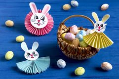Child makes bunnies for Easter decoration. Step 16. Child makes bunnies out of paper for Easter decoration. Creative idea for children`s party. DIY concept. Step royalty free stock photography